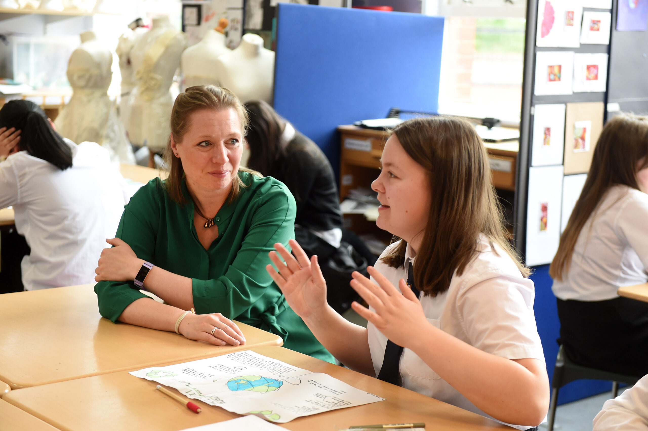 Pic credit © Ian Watson  20th May 2019 Hillhead High School,Hillhead, Glasgow.  Rebecca Ricketts from the Circular Economy team at the Chamber Of Commerce makes a judges visit to discuss the latest project with pupils and principal art teacher Ross Reid.  Rebecca Ricketts with pupil Daisy Kirk (14)